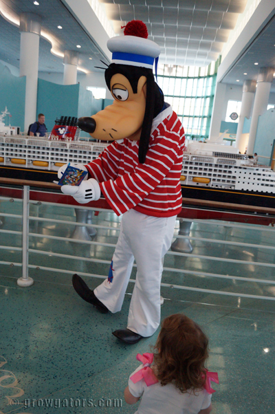 Goofy signing her autograph book before we embarked.