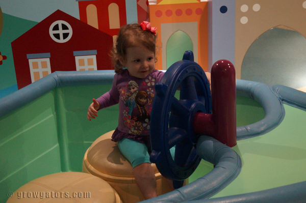She loved this pretend boat in the It's a Small World nursery